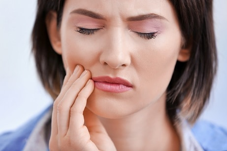 How can I prevent cavities under my fillings?
